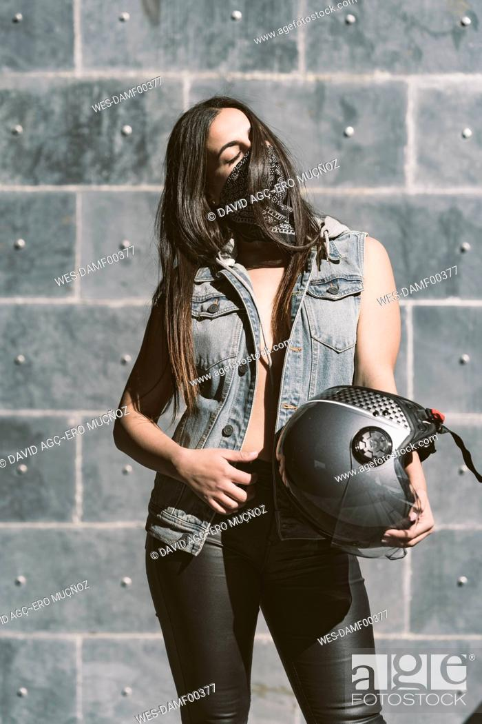 Stock Photo: Portrait of sexy young woman with motorcycle helmet.