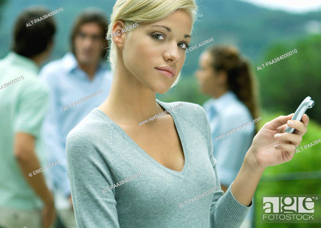 Stock Photo: Woman holding cell phone.