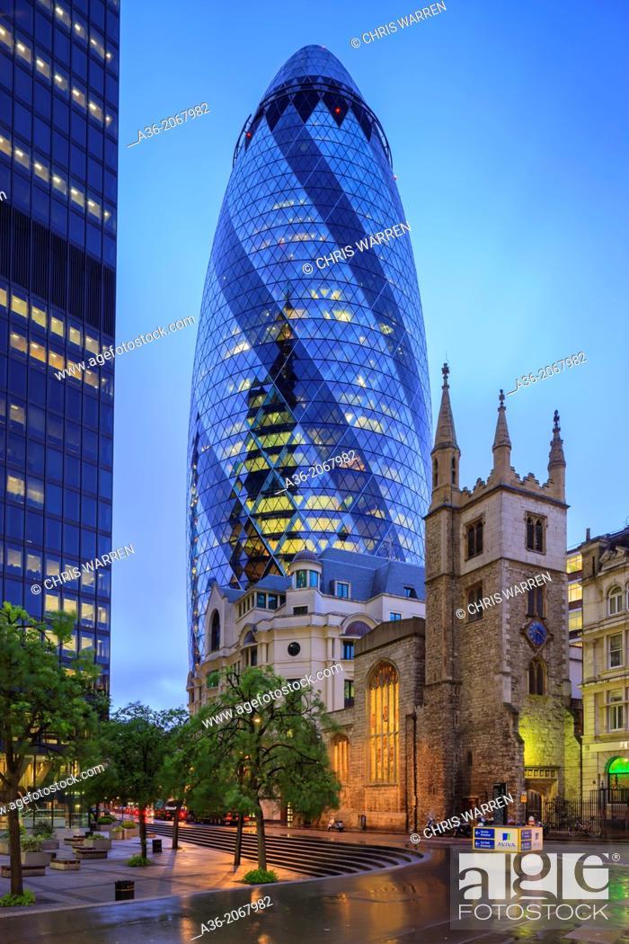 Stock Photo: Gherkin 30 St Marys Axe with St Andrew Undershaft Church London England.