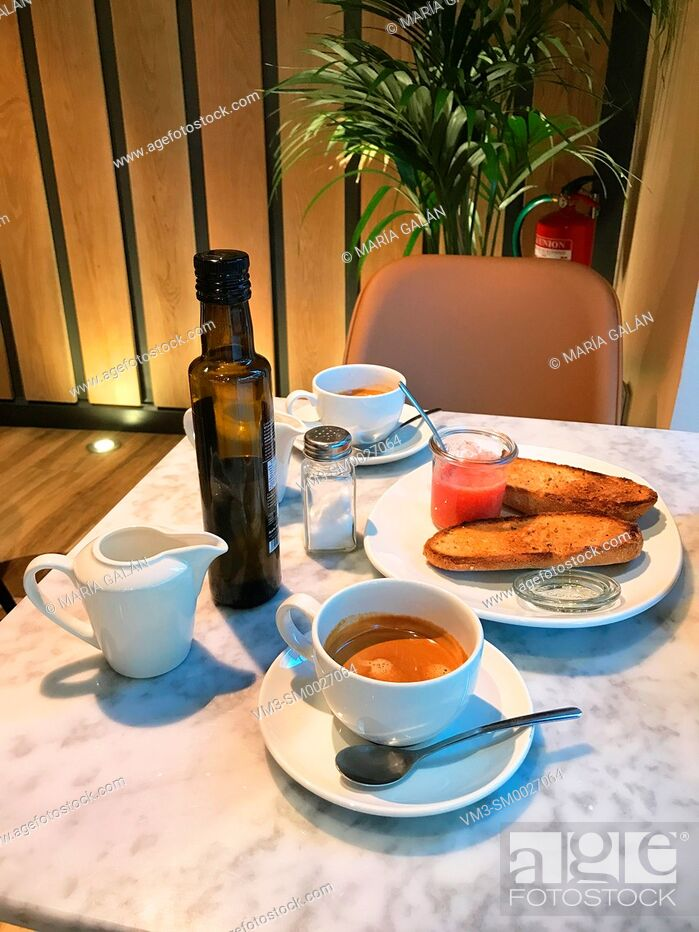 Stock Photo: Spanish breakfast: two cups of coffee, olive oil, toast and tomato.
