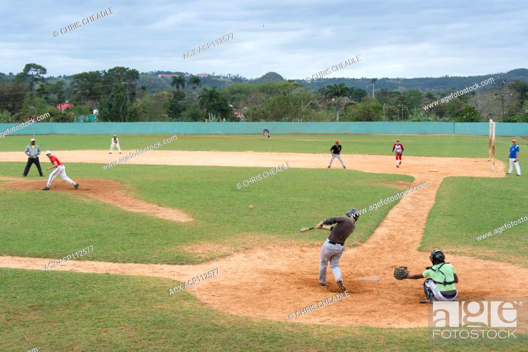 Stock Photo: Recreational baseball on a Sunday afternoon, Vinales, Cuba.