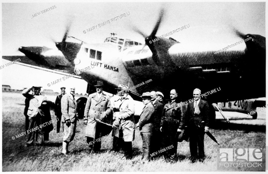 Stock Photo: Adolf Hitler and a group of Nazi leaders standing in front of a Lufthansa plane in an airfield.