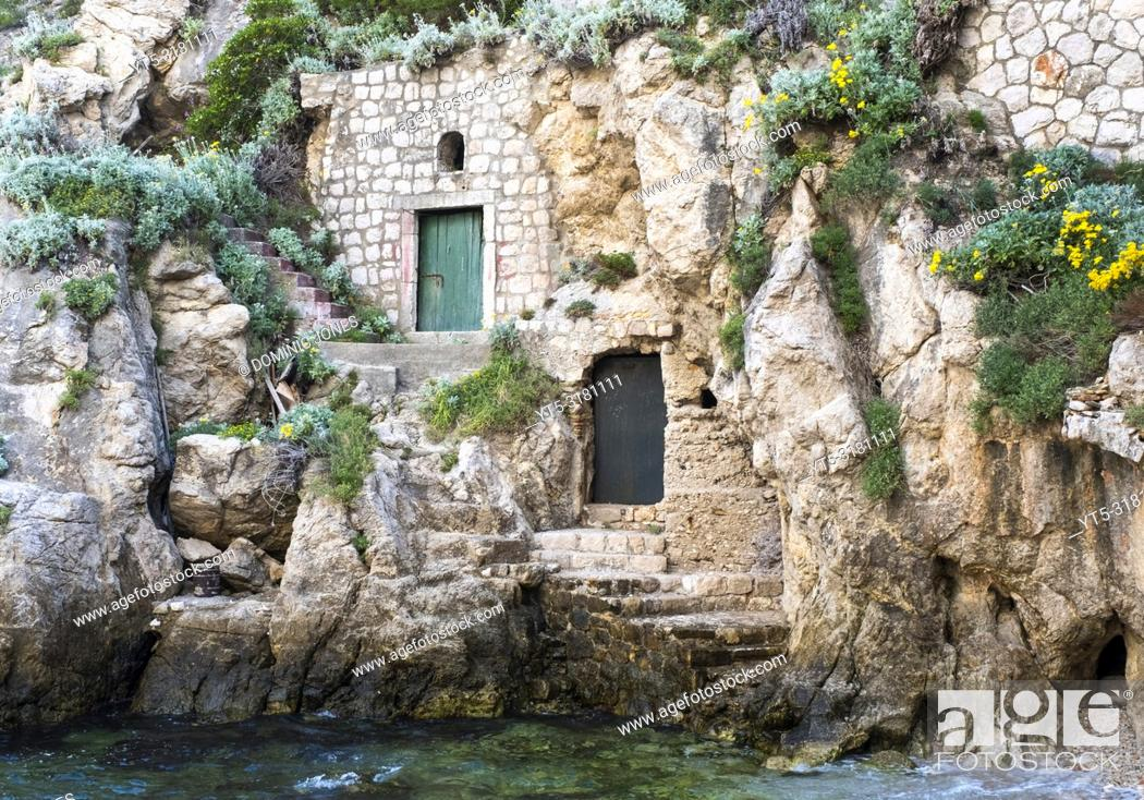 Stock Photo: Doors in the rockface at Pile Harbour, Dubrovnik, Croatia, Europe.