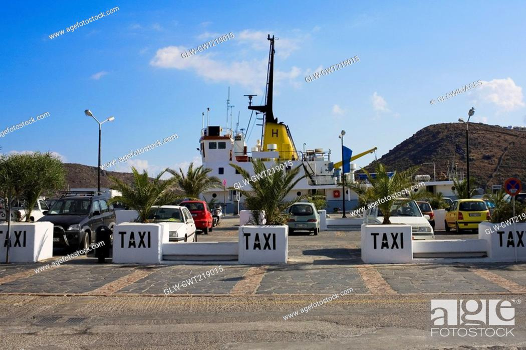 Stock Photo: Taxi at a taxi stand in a city, Patmos, Dodecanese Islands, Greece.