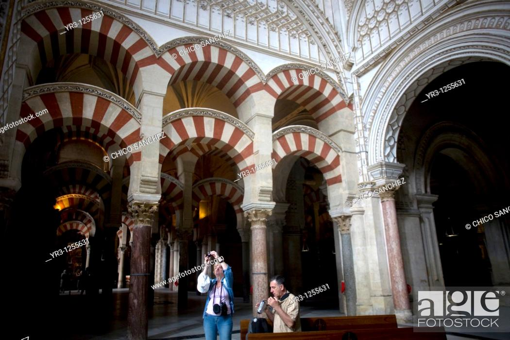 Stock Photo: Tourists visit the Mosque and Cathedral of Cordoba, Andalusia, Spain.