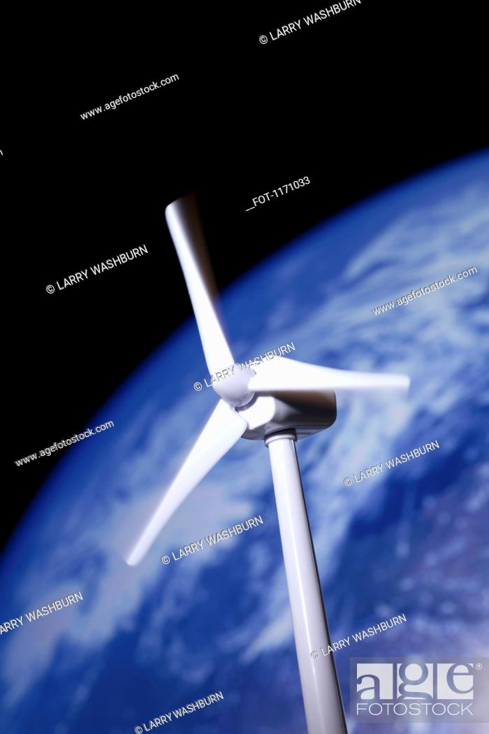 Stock Photo: A model of a wind turbine in front of the planet earth.
