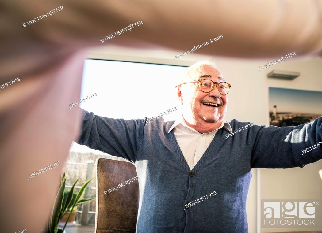 Stock Photo: Happy senior man with outstretched arms.