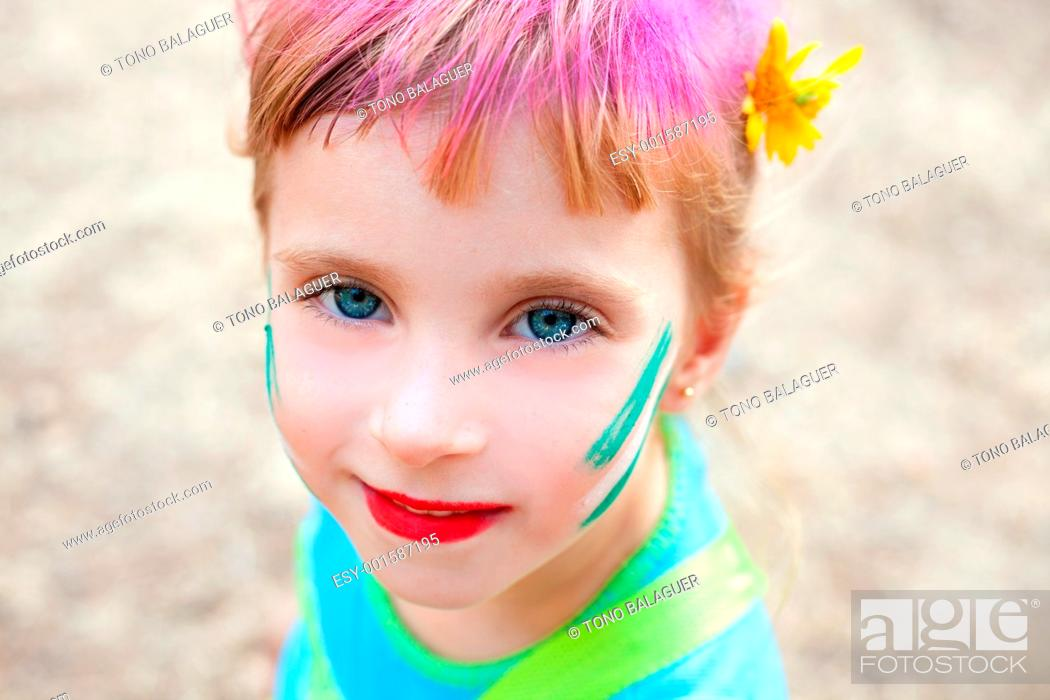 Stock Photo: blue eyes children girl painted face makeup in outdoor party.
