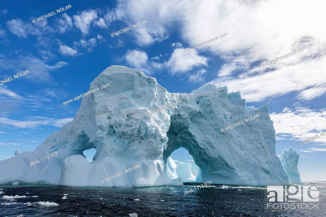 Stock Photo: Huge arched iceberg near Petermann Island, western side of the Antarctic Peninsula, Southern Ocean, Polar Regions.
