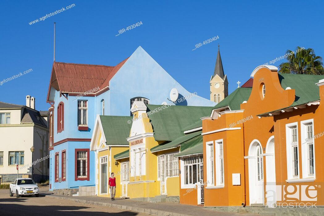 Stock Photo: Colourful houses from German colonial times, behind the tower of the rock church, old town of Lüderitz, Namibia, Africa.