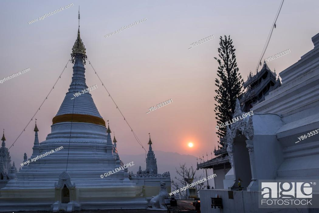 Stock Photo: Sunrise at the Buddhist temple of Wat Phra That Doi Kong Mu, Mae Hong Son, Thailand.