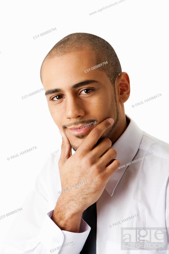 Stock Photo: Torso of a handsome African Hispanic business man in white shirt and gray tie with hand on chin and thinking, isolated.