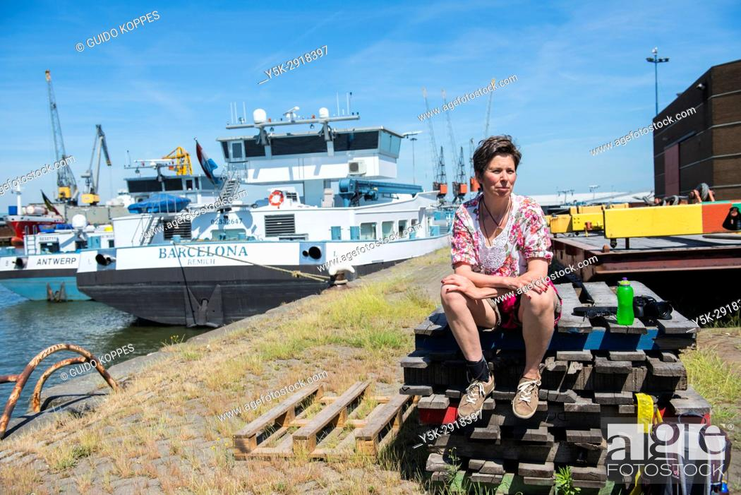 Stock Photo: Merwehaven, Rotterdam. Taking a break on a stack of pallets during a summer-day harbour stroll.