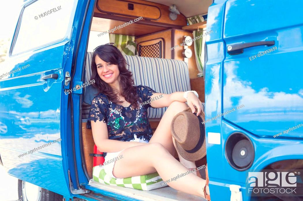 Stock Photo: summer holidays, road trip, travel and people concept, young woman resting in minivan car.