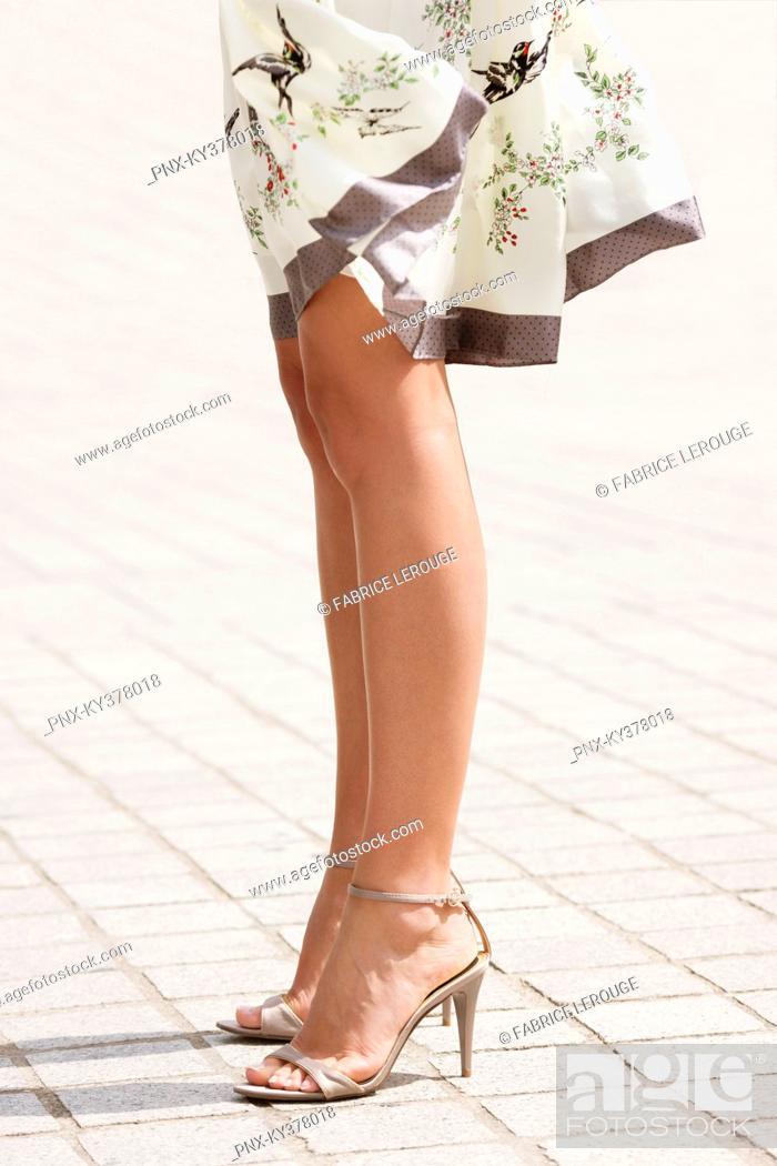 Stock Photo: Low section view of a woman, Paris, Ile-de-France, France.