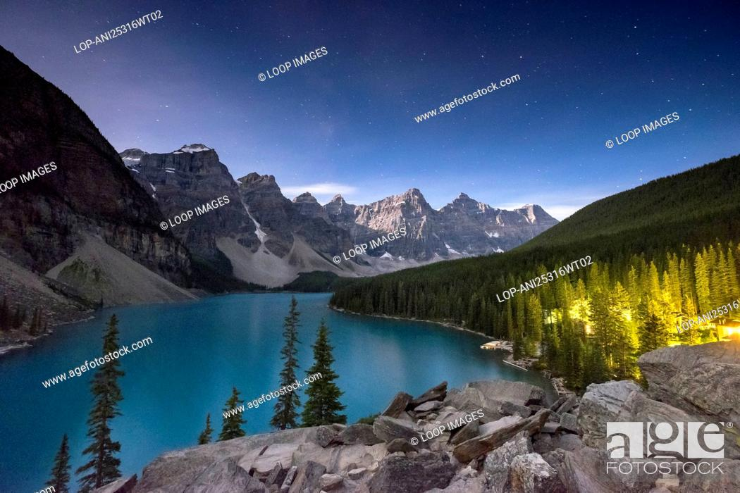 Stock Photo: Night sky over Moraine Lake and moonlit valley of the ten peaks in the Canadian Rockies.