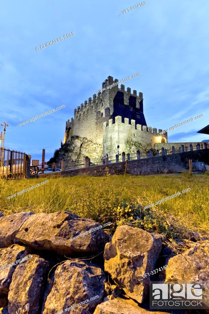 Imagen: Evening falls on the imposing castle of Tenno. Trento province, Trentino Alto-Adige, Italy, Europe.