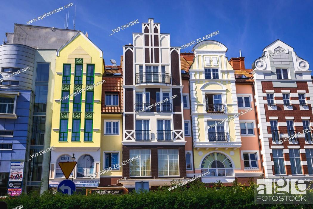 Stock Photo: Renovated tenement houses on the Old Town of Kolobrzeg city in West Pomeranian Voivodeship of Poland.