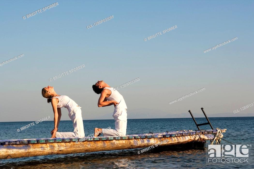 Stock Photo: Couple Practicing Yoga.