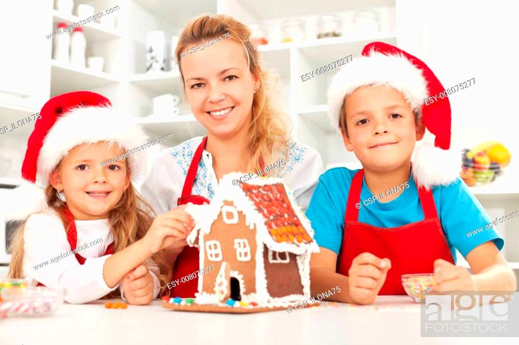 Stock Photo: Happy christmas family in the kitchen.