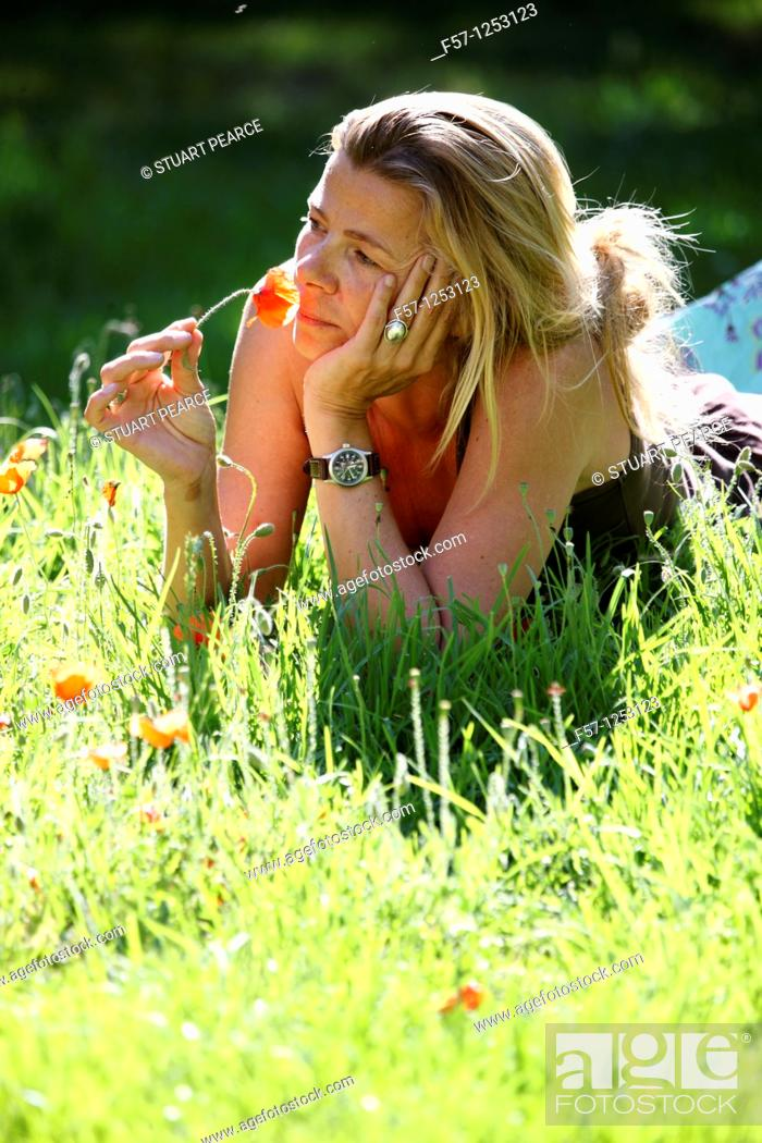 Stock Photo: Woman relaxing in the grass.