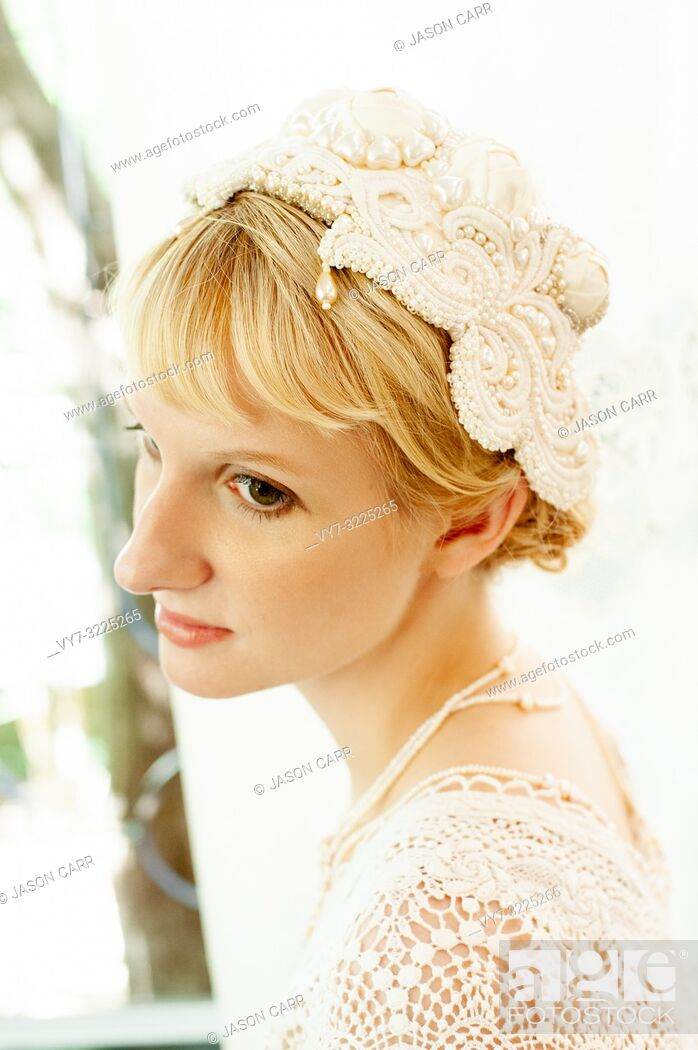 Stock Photo: Caucasian female model poses for wedding pictures in the studio.
