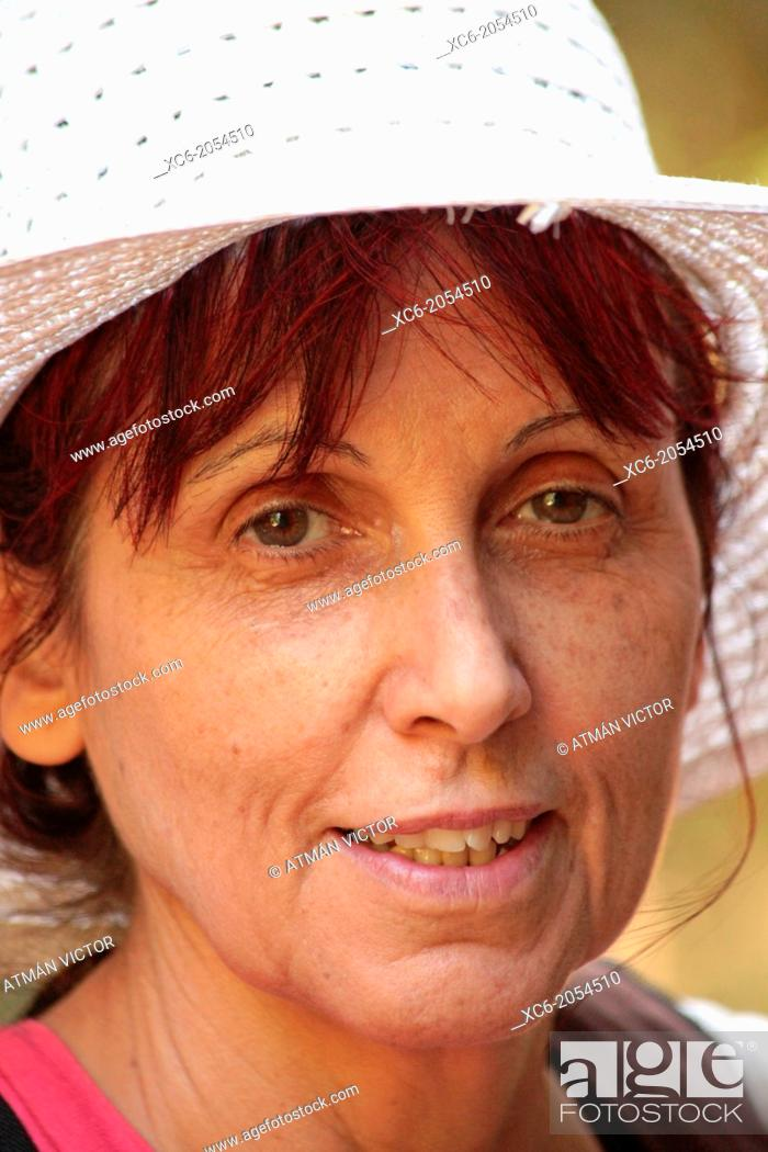 Stock Photo: closeup face portrait of a spanish adult woman.