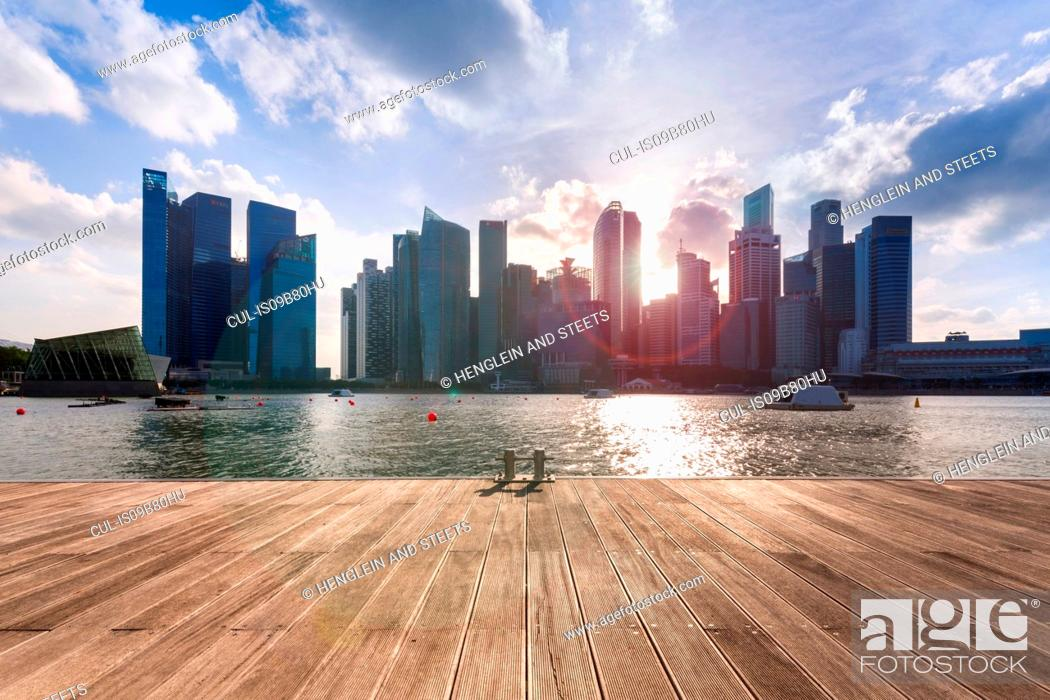 Stock Photo: Waterfront view of city skyline, Singapore, South East Asia.