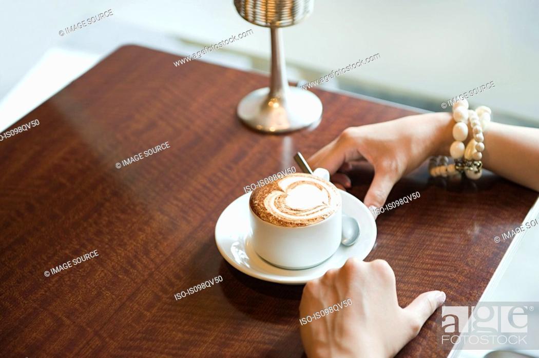 Stock Photo: Woman having coffee.
