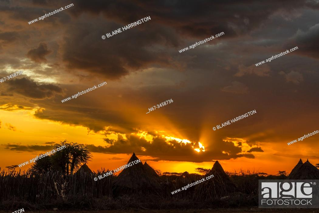Stock Photo: Silhouette of huts at sunset, a Hamer tribe village, near Turmi, Omo Valley, Southern Nations Nationalities and People's Region, Ethiopia.