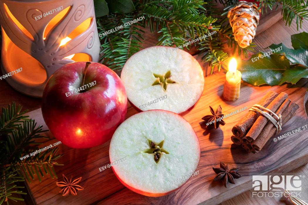 Stock Photo: Christmas decoration with apples cut in two halves with a star in the middle.