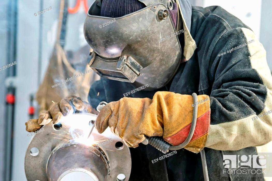 Stock Photo: Welding works on manufacturing of units and parts of pipelines.