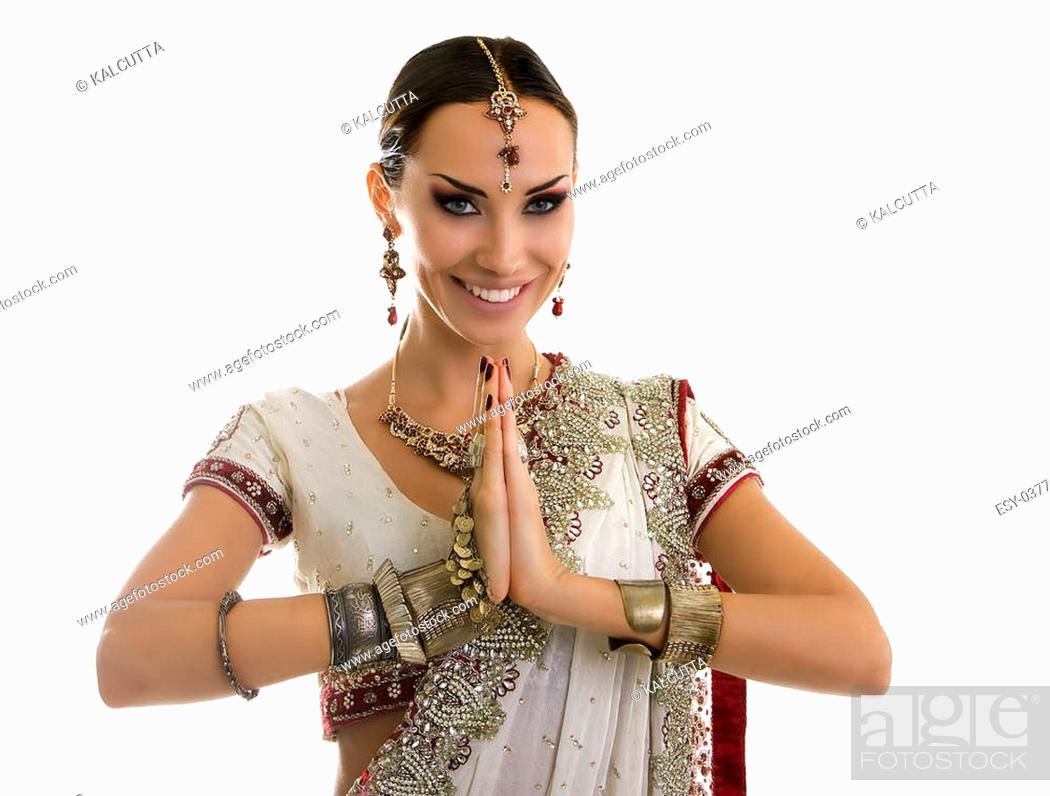 Stock Photo - Namaste: Beautiful Young smiling Indian Woman in Traditional Clothing with Bridal Makeup and Oriental Jewelry. Beautiful Girl Bollywood dancer ...