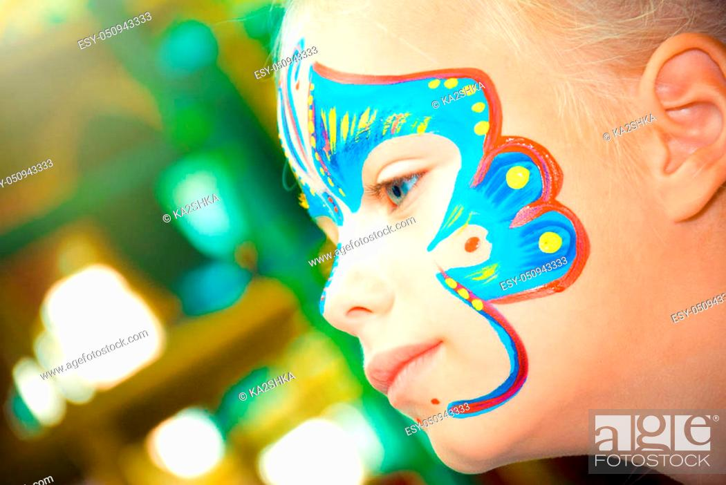Photo de stock: Pretty Girl Child with face painting. Make up.
