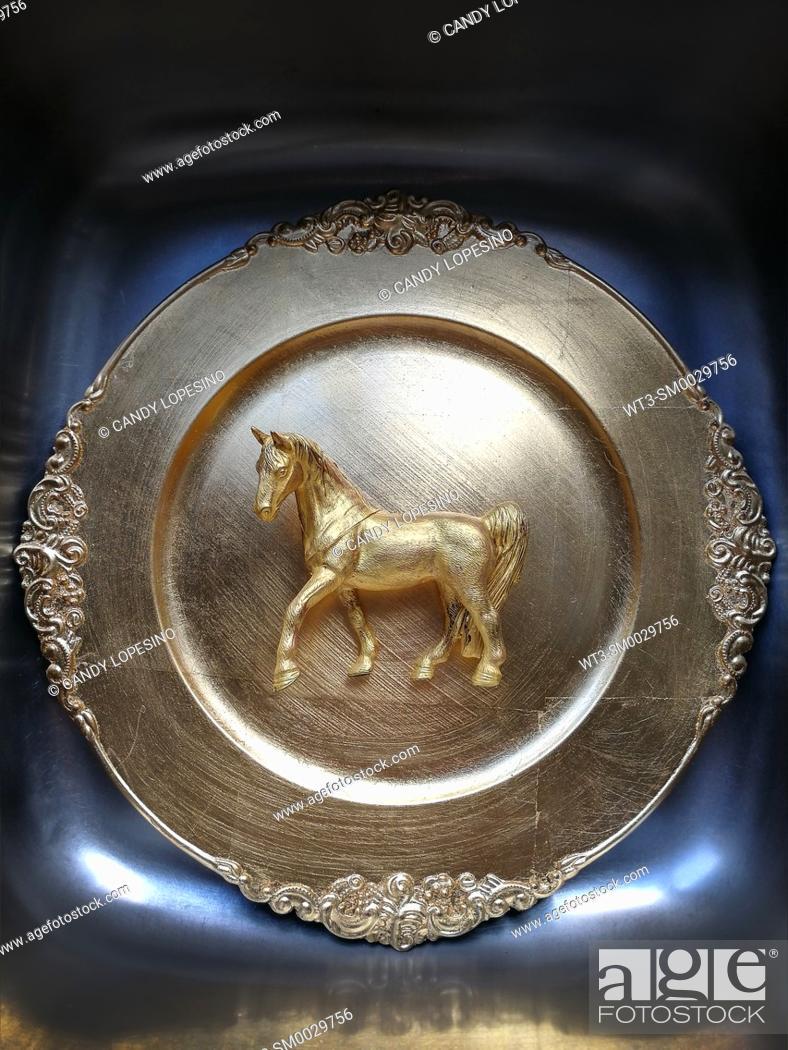 Stock Photo: Golden horse on golden background.