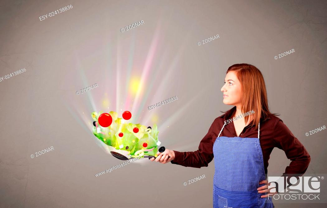 Stock Photo: Young woman cooking fresh vegetables.
