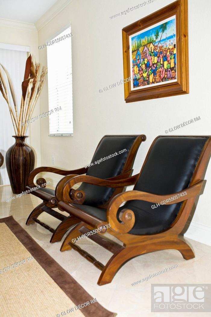 Photo de stock: Armchairs in a living room.