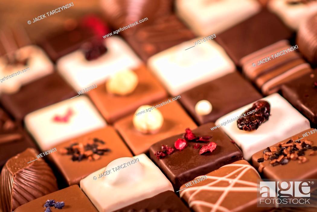Stock Photo: Assortment of fine chocolate candies, white, dark and milk chocolate.