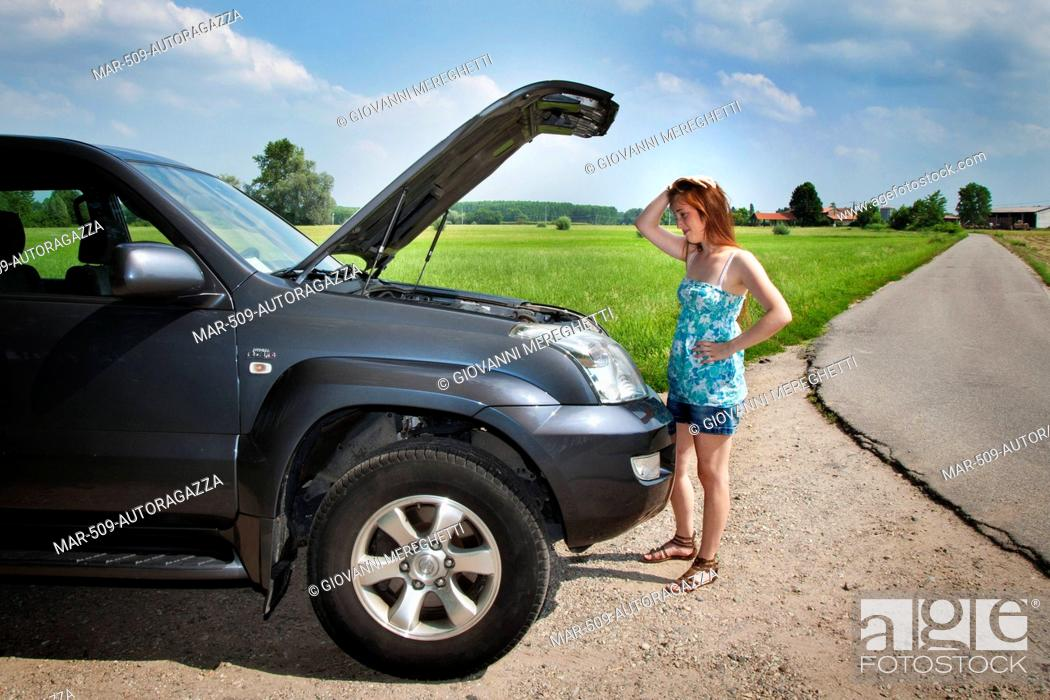 Young Woman With A Broken Down Car Stock Photo Picture And