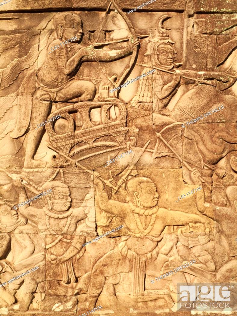 Stock Photo: Cambodia - Bas-relief with battle scenes in the Bayon, a temple in the centre of Angkor Thom, the 'Great Capital' of the Khmer empire in Angkor  The temple.