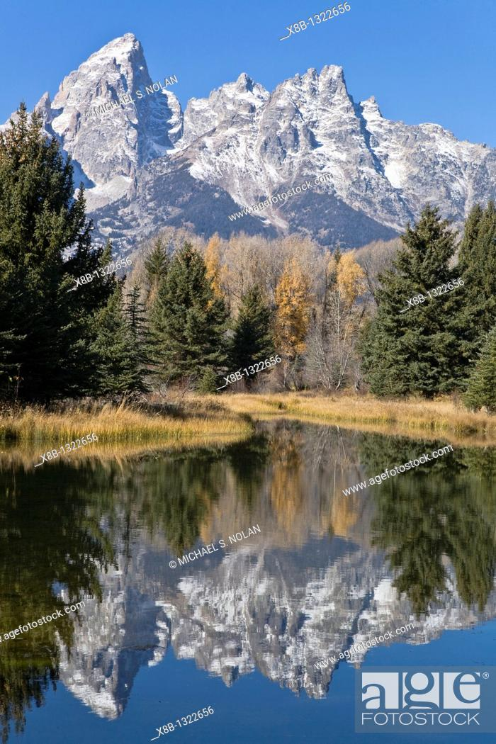Stock Photo: Reflected light on water from the Grand Teton Mountain Range, outside of Jackson Hole, Wyoming  This image was shot from the Schabawacker Landing on the snake.