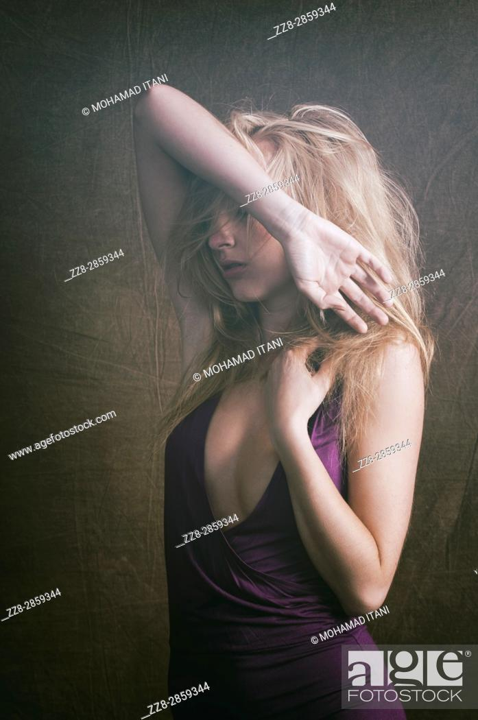 Stock Photo: Slim blond woman hands on head in pain.