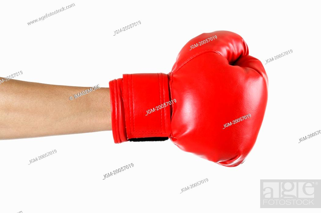 Stock Photo: Close-up of human hands wearing a boxing glove.