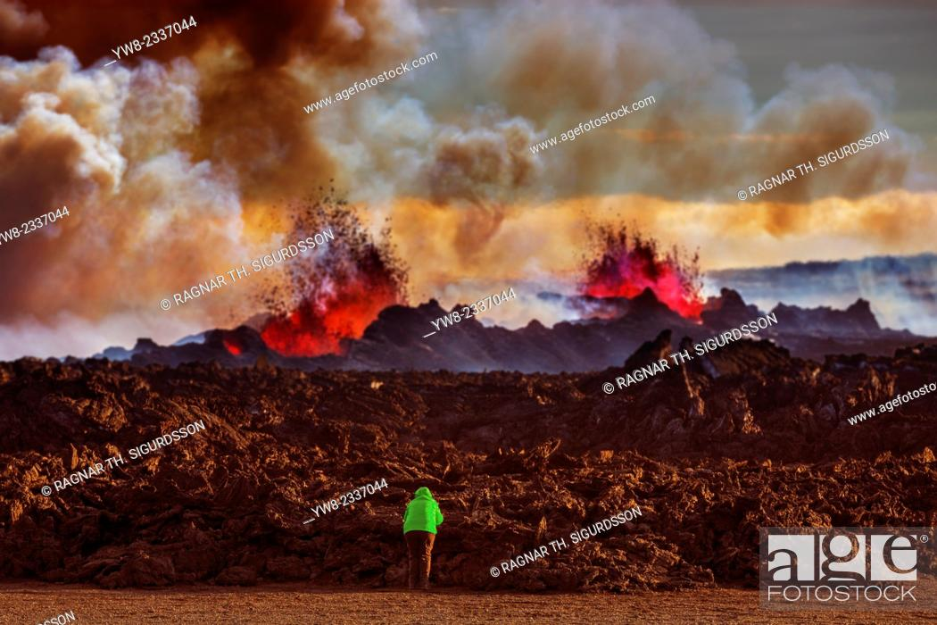 Stock Photo: Person close to the new lava. August 29, 2014 a fissure eruption started in Holuhraun at the northern end of a magma intrusion.