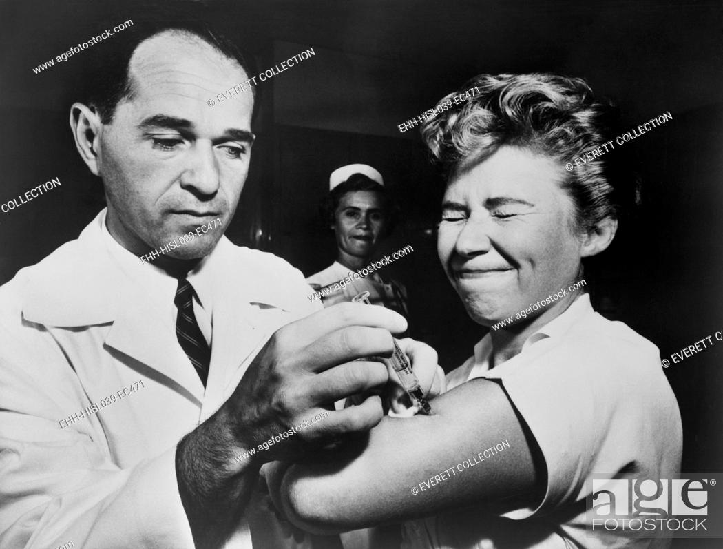 Stock Photo: A nurse at Montefiore Hospital receives a flu vaccination in 1957. The 1956-58 Asian Flu was a category 2 flu pandemic that originated in China in early 1956.