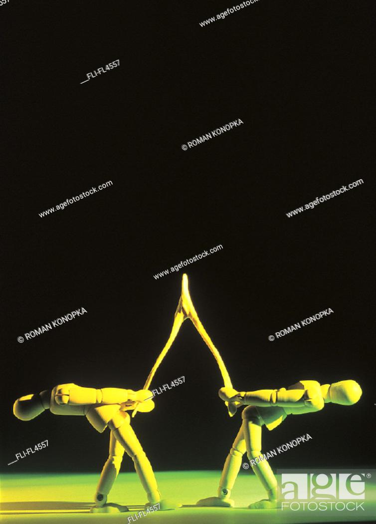 Stock Photo: Mannequins Pulling Wishbone.