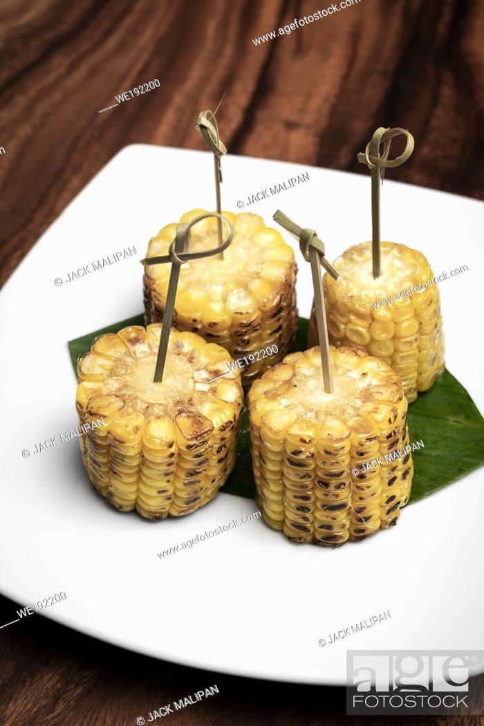 Stock Photo: sweet corn on the cob vegetarian tapas snack food.