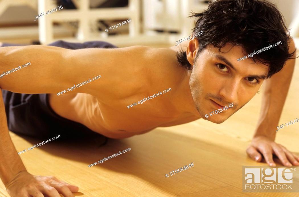 Stock Photo: Darkhaired Man doing Press-Ups - Sportiness - Gymnastics.