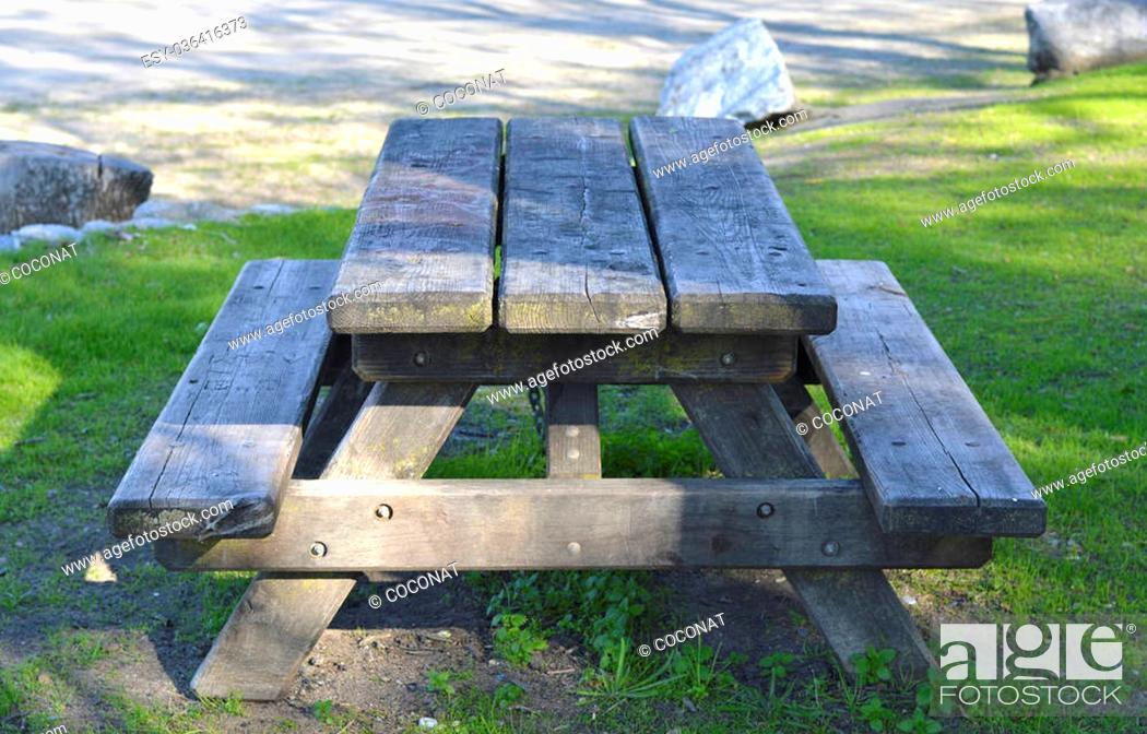 Stock Photo: Wooden picnic table in the park walking holidays.