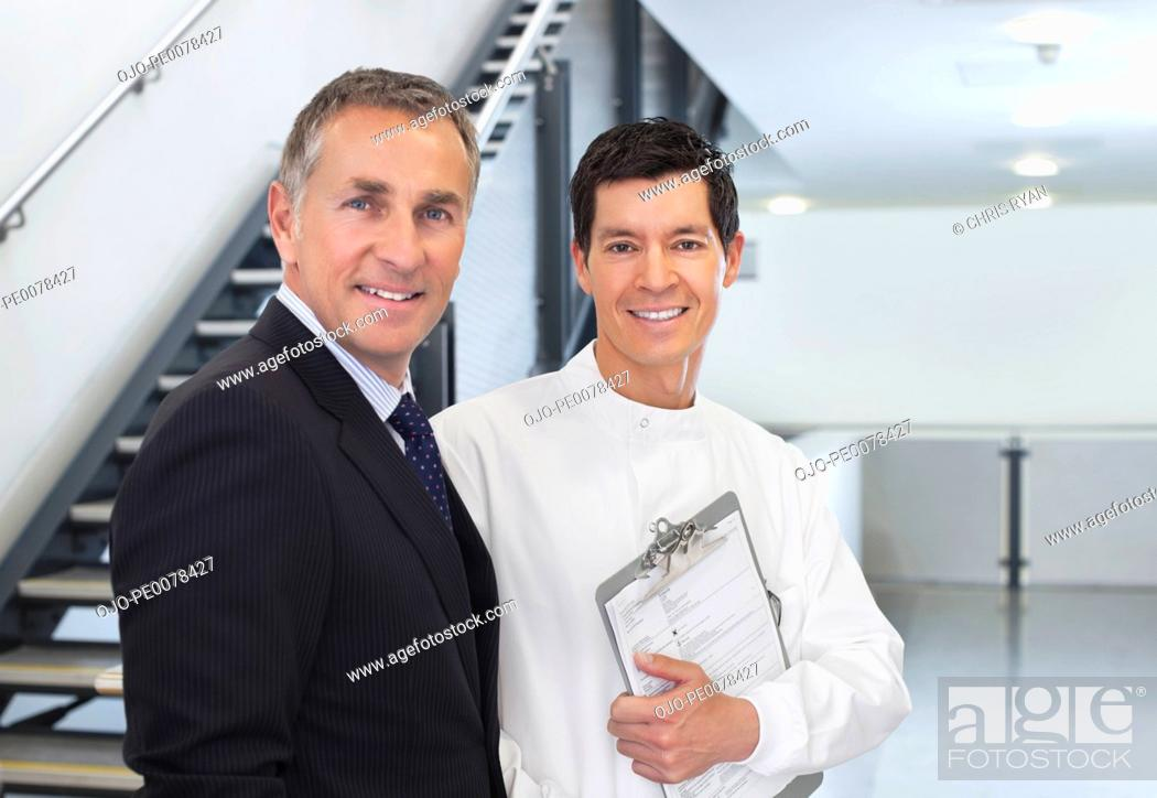 Stock Photo: Scientist and businessman talking in office.